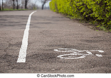 Symbol of bicycle lane drawn on the asphalt - Separate...