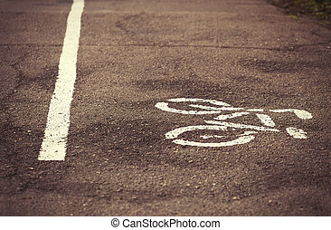 Symbol of bicycle lane drawn on the asphalt - White bicycle...