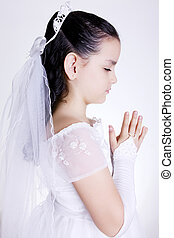 Pray - Girl praying with her hands clasped and white dress...