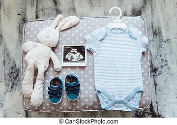 newborn baby clothes on textile background - newborn baby...