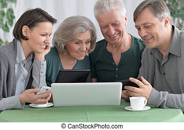 Happy Family using laptop - Portrait of a happy family...