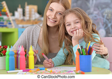 Elementary school art class with beautiful teacher
