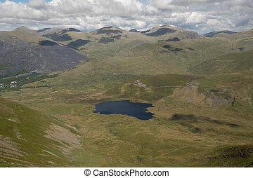Llyn Dwythwch. - Lake, Llyn Dwythwch, nestled in a grassy...
