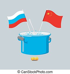 Political kitchen. Russia and China community. Cook soup in one pot. Russian flag and Chinese flag