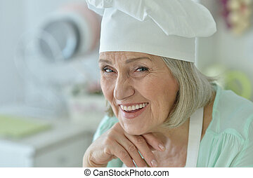 Senior chef woman - Portrait of a senior chef woman happy