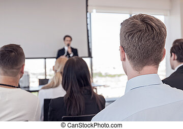 Business presentation - Business man speaking at...