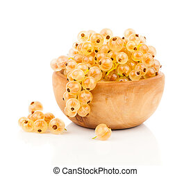 White currant fruit in a wood bowl, isolated over white...