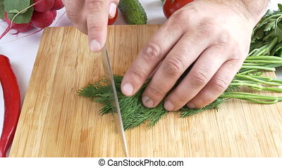 Dill being chopped - Chopped Dill On Wooden Board Close-up