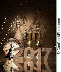 New Years Eve celebration background with pair of flutes,...
