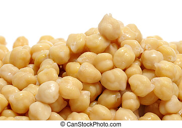 chickpeas - closeup of a a pile of chickpeas on a white...