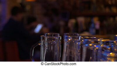 Cinemagraph - man using tablet PC at the bar - Cinemagraph -...