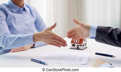 business partners with house keys and contract - business,...