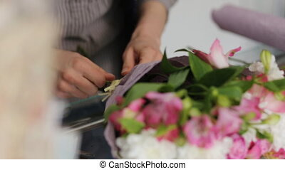 Close-up of bouquet making process in a flower store.