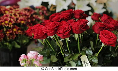 Close up of a bouquet made of red roses and other flowers...