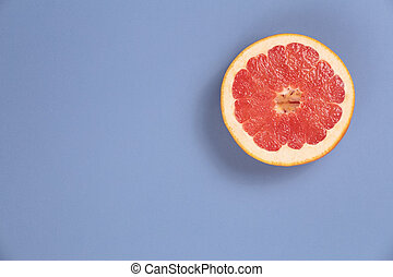 Photo kinds of pop art. Grapefruit on a blue background