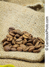 Heap of coffee beans on sackcloth