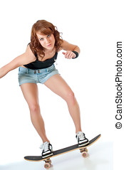 Pretty skateboarder - Beautiful young woman riding a...