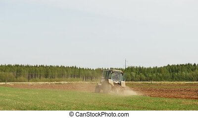 Tractor drive in the field plowed