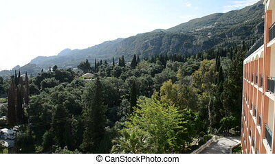 The view on mountains, cypress and olive trees in Corfu...