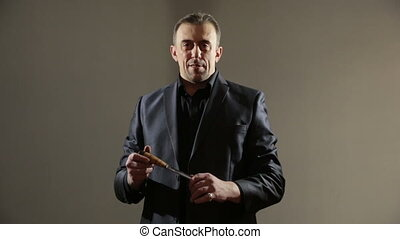 male gangster in a business suit with a knife businessman...
