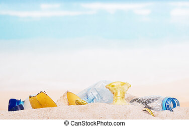 Household and food waste in the sand on beach, background. -...