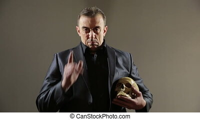 Businessman holding skull. gray background - Businessman...