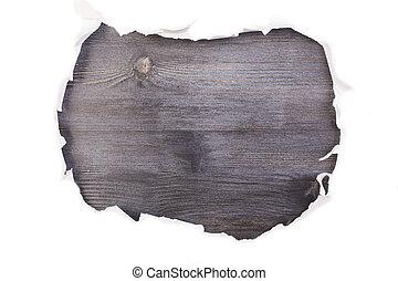 Dark wooden surface torn paper