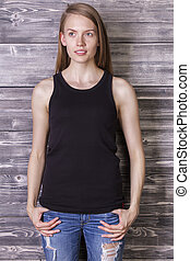 Woman in tank top - Attractive caucasian woman wearing plain...
