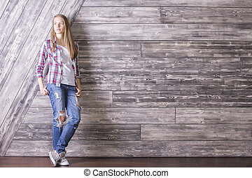 Young woman on wooden background - Casually dressed young...