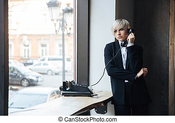 Pretty blonde young woman talking on the phone - Pretty...
