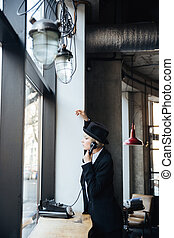 Stylish pretty blonde girl talking on the phone - Stylish...