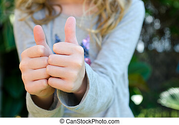 Thumbs up - Close up of child giving two thumbs up