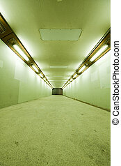 long tunnel with lamps and nobody walking