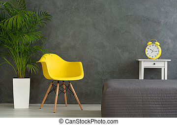 Vivid colors in grey room - Yellow chair and clock alarm and...