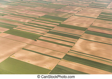 Vojvodina's land from sky - Aerial view of a green rural...