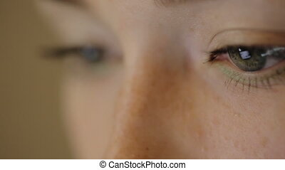 It is a picture of winking eyes of woman working. The view...