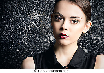 girl with brown eyes - Vogue shot of a brunette young woman...