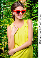 happy day - Pretty smiling woman in bright yellow dress and...