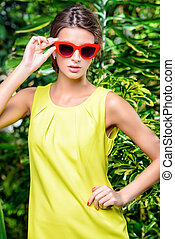 pin-up summer - Stylish young woman in bright yellow dress...
