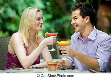 Couple Having Drinks - An attractive caucasian couple having...
