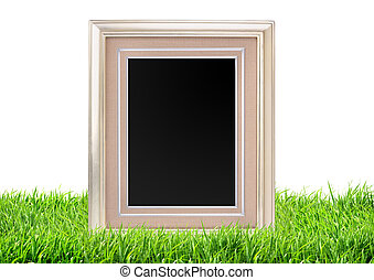 Photo frame on green grass nature background
