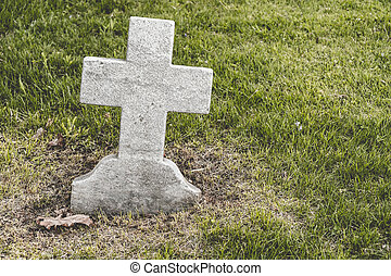 Cross shaped blank Headstone in a cemetery