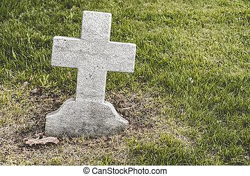 Cross shaped blank Headstone in a cemetery