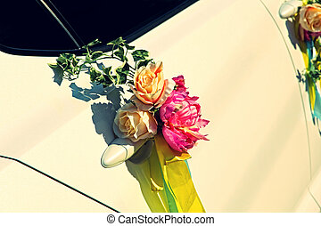 Wedding flowers bouquet on car door.Toned image. - Wedding...