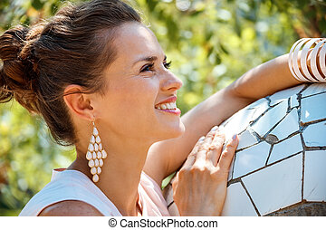 Portrait of happy young woman in Park Guell, Spain - Get...
