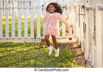 kid girl toddler playing jumping in park outdoor
