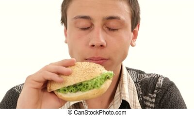 Tasty Burger on white background. - Portrait of a young man...