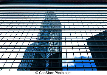 Business buildings reflection with blue sky