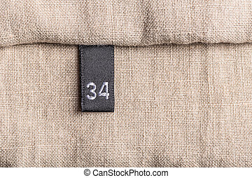 Clothing label - Close-up of clothing label with 34 size