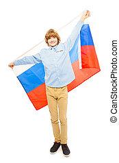 Teenage boy in full height waving Russian flag - Teenage...